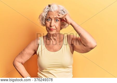 Senior grey-haired woman wearing casual clothes worried and stressed about a problem with hand on forehead, nervous and anxious for crisis