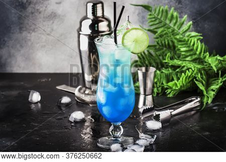 Blue Hawaiian Or Blue Lagoon Cocktail - Summer Alcoholic Drink With Vodka, Liqueur, Tonic, Pineapple
