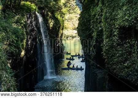 View Of Takachiho Gorge (takachiho-cho) From A Trail On The Cliff With A Waterfall And Many Tourist