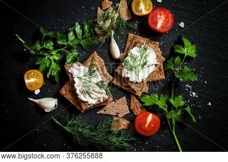 Crisp Rye Bread With Soft Curd Cheese With Herbs And Spices On A Dark Background, Food Background, T
