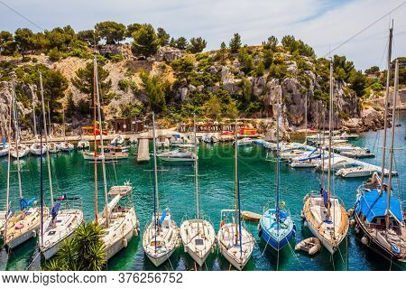 Calanques are the attractions of Provence. Picturesque bays of the Mediterranean Sea and the Cote d'Azur. Great sailing yachts on the azure water of the Fjord. The concept of photo tourism