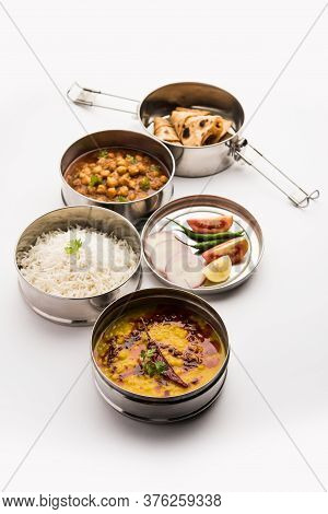 Indian Veg Lunchbox For Office Of Workplace With Chole, Dal Fry Rice And Chapati