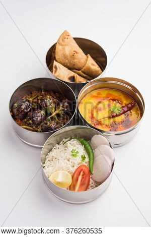 Indian Veg Lunchbox For Office Of Workplace With Baingan Masala, Dal Fry Rice And Chapati