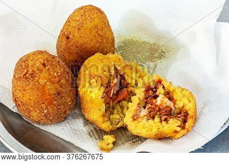 Hot Palatable Arancini On The Paper Napkin. Sicily Street Food. Selective Focus