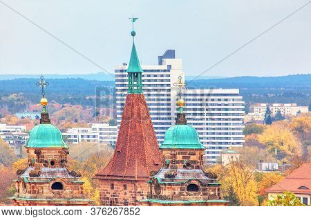 Spire And Steeple Of Old Town . Top View Of Cathedral In Nuremberg . German Cityscape
