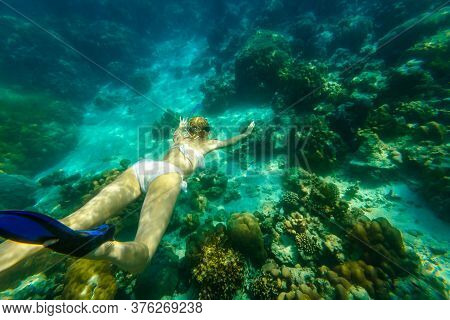 Back And Top View Of A Woman Swimming Deep In Apnea Of Surin Islands, Andaman Sea Reef. Ko Surin Mar