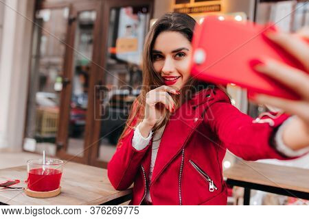Interested Cute Girl Drinking Tea And Taking Photo Of Herself. Outdoor Portrait Of Sensual Young Wom