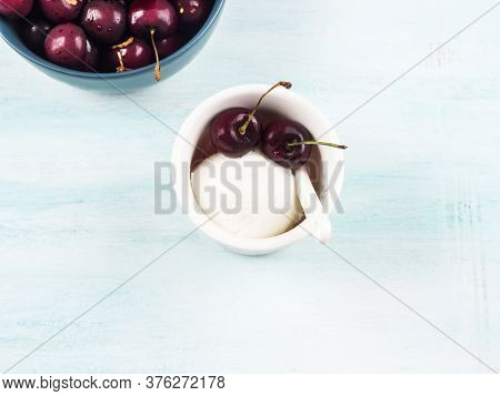 Frozen Yogurt Dessert In Cup With Cherries. Fresh Gelato On Turquoise Background. Flat Lay