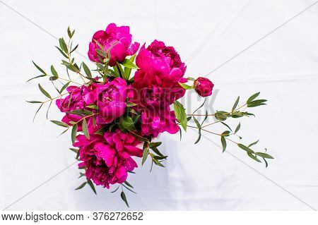 Bunch Of Peonies With Eucalyptus Sprigs, Isolated On White