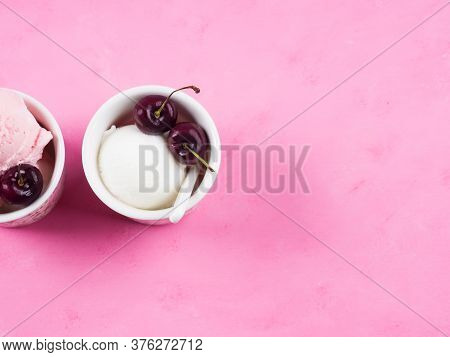 Two Cups With Fresh Gelato Scoops With Cherries On Pink Background. Top View
