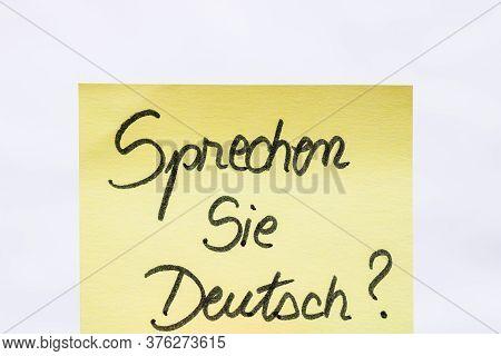 Sprechen Sie Deutsch ( Do You Speak German) Handwriting Text Close Up Isolated On Yellow Paper With