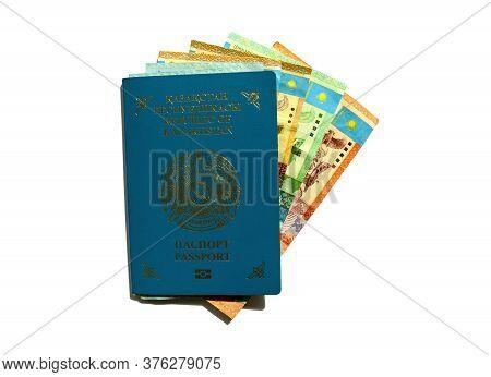 Kazakhstan Passport With National Currency Tenge Isolated On White Background. Kz Passport And Kazak