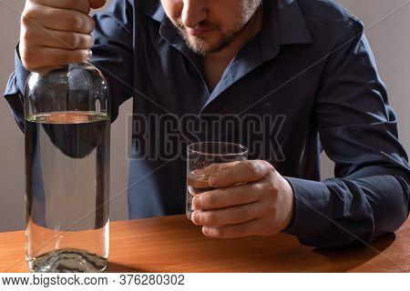 A Man And A Glass Of Vodka. Alcoholism, Alcohol Addiction, Delirium Tremens.