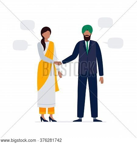 An Indian Man And Woman Are Shaking Hands. Two Politicians In An Official Suit And National Clothes