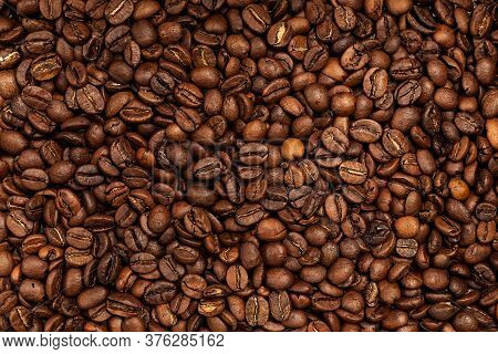 Background Coffee Beans. Pattern Of Brown Roasted Coffee Bean Beans