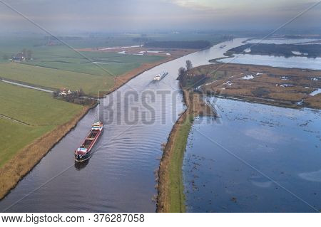 Aerial View Of Inland Freight Ships In Canal In Friesland. The Netherlands
