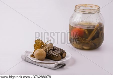 Pickles On A White Plate. Prepared Homemade Dish Pickles From A Jar. The Concept Of Home Cooking.