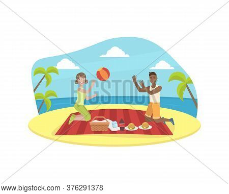 Happy Couple Having Picnic And Playing Ball, Young Man And Woman Having Picnic On Tropical Beach At