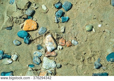 Multi-colored Colorful Sea Pebbles, Natural Background, Texture. Close-up Texture Of Colorful Sea Pe
