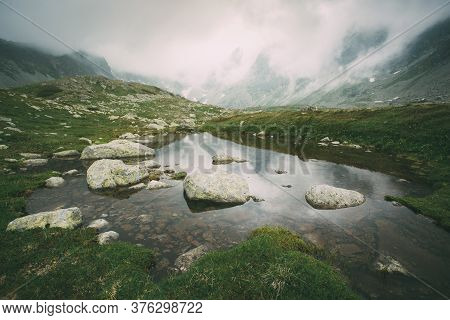 Lake In Foggy Mountains In The High Tatras.