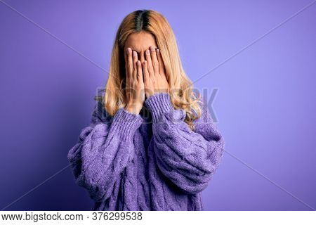 Young beautiful blonde woman wearing casual turtleneck sweater over purple background rubbing eyes for fatigue and headache, sleepy and tired expression. Vision problem