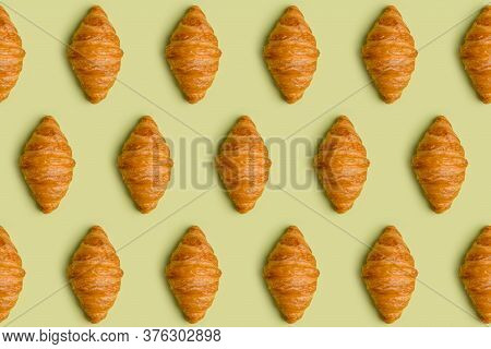 Pattern With Croissants At Minimal Light Green Background. Top View, Flat Lay, Concept Of Modern Min
