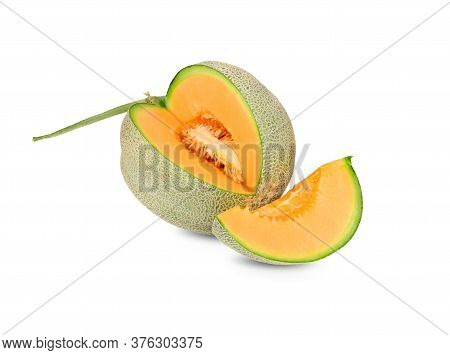 Whole And Cut Ripe Muskmelon With Stem On White Background
