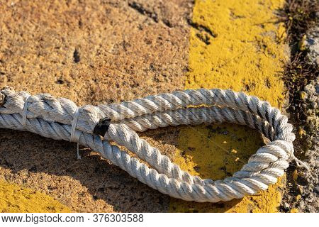 Closeup Of Ropes For Mooring Boats On The Quayside In Liguria, Italy, Europe