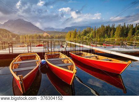 The Colorful Boats On Strbske Lake In Slovakia.
