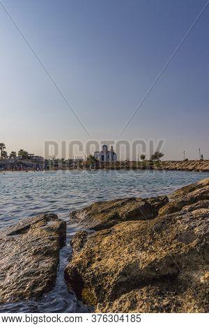 August 2019. Paralimni Cyprus.agios Nikolaos Chapel And The Beach, Paralimni, Cyprus, Europe,