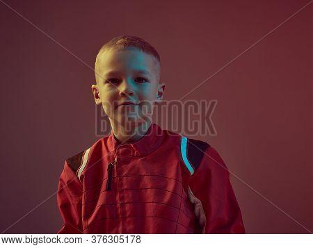 Cool Boy Child Racer In Racing Suit, Standing In Neon Light. Kart Racing School Poster. Competition