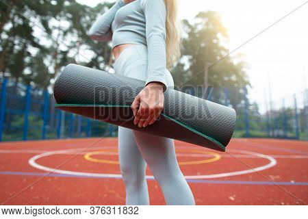 Fitness, Sport And Healthy Lifestyle Concept. Cropped Image Of Young Girl In Gray Sports Wear, Holdi