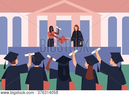 Graduates Are Awarded Diplomas And Scroll. Students In A Black Graduation Gown And Graduation Hat. F