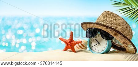 Summertime Vacation Concept. Time To Relax. Last Minute Deals. Alarm Clock With Straw Hat, Starfish