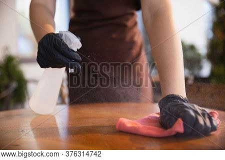 The Waitress Works In A Restaurant In A Medical Mask, Gloves During Coronavirus Pandemic. Representi