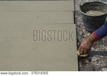 Cement Surface Adjusting With Hand Of Worker And Waiting For Cure By Sunligth In Out Door In Hands H