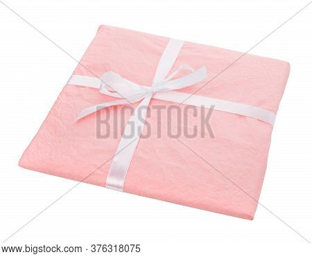 Gift Wrapped In Paper With Ribbon Bow On A White Background.