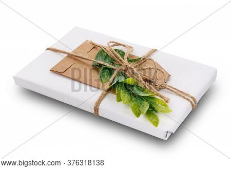 Decorated Gift Wrapped In Paper On A White Background.
