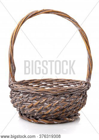 Dark Brown Round Wicker Basket With High Handle. Isolated.