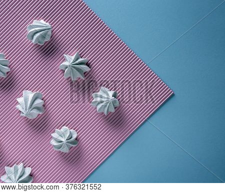 Flat Lay With Delicate Light Green Meringue Cookies. Meringues Are Lying In Rows On Pink Striped Tex