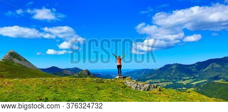back view of hiker tourist girl on the mountain in France, Cantal