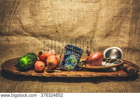 Shot To A Traditional Plate With Food From Transilvania Standing On A Burlap