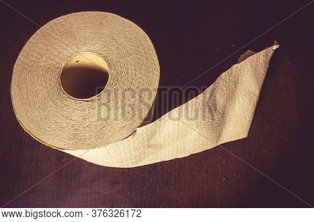 Close Up Shot To A Toilette Paper On A Wooden Background
