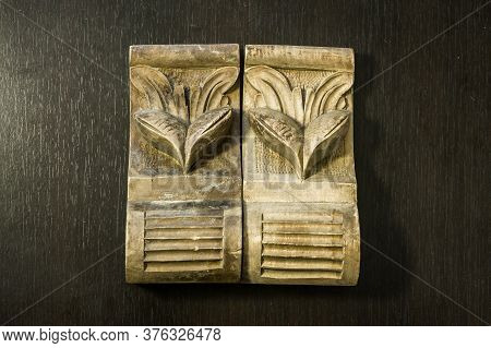 Beautiful Pattern Sculpted In Wood On A Dark Wooden Background