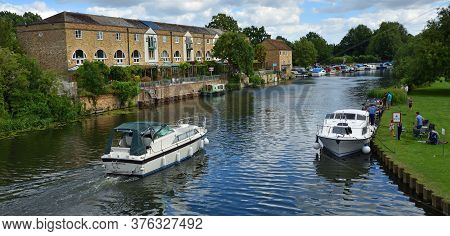 St Neots, Cambridgeshire, England - July 04, 2020:  The Rive Ouse At St Neots With River Cruisers An