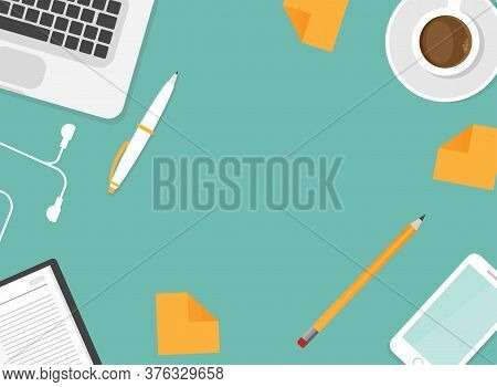 Workplace With Smartphone, Pen, Coffee, Earphones And Laptop. Workplace Isolated On Blue Background.