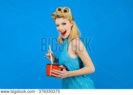Winking Woman In Kitchen With Saucepan And Wooden Spoon. Pinup Girl With Fashion Hair, Trendy Makeup