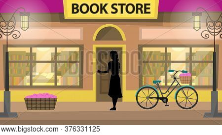 Concept Of Bookstore, Learning And Education. Young Woman Silhouette With Bicycle At The Entrance To