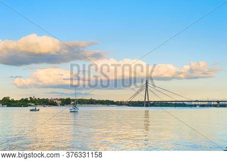 River Dnieper, Yacht And Pivnichnyi (northern) Bridge. Kiev, Ukraine