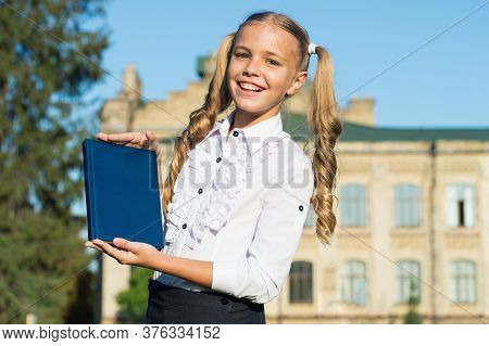 Product For Book Lover. Happy Child Hold Book Outdoors. Little Girl Presenting Product. Product Prom